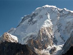 Just after leaving Concordia, the sun finally hit Broad Peak. The North Summit is on the far left, the Central Summit is slightly out of view in the middle, and on the far right is the Main Summit. The first ascent of Broad Peak North summit was made by Renato Casarotto on June 28, 1983. The first traverse of the three Broad Peak summits was completed by Jerzy Kukuczka and Wojtek Kurtyka. They climbed the west ridge to the North summit, continued along the ridge to the Central summit. The pair then descended to Broad Col from where they followed the original route over the Forepeak to the main summit on July 17, 1984. The first ascent of the Broad Peak Central or Middle summit was completed by Poles Kazimierz Glazek and Janusz Kulis on July 28, 1975 while three other members huddled 40m away and a few metres lower.